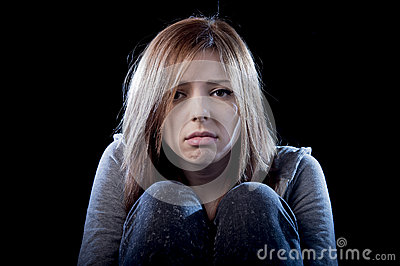 Teenager girl feeling lonely scared sad and desperate suffering depression bullying victim Stock Photo