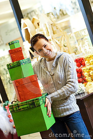 Teenager girl with gift boxes