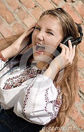 Teenager girl in headphones