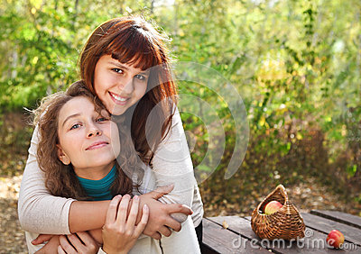 Teenager girl with her mother