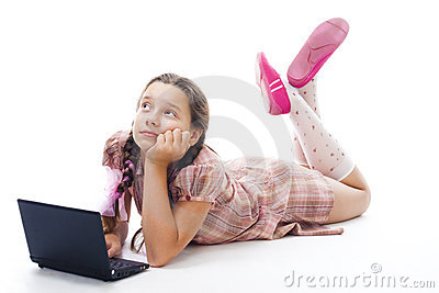 Teenager girl with laptop thinking laying