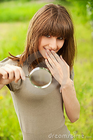 Teenager girl with magnifier