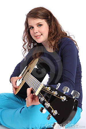 Teenager girl musician playing acoustic guitar