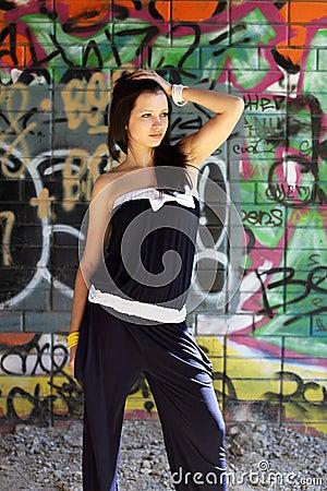Teenager girl near the walls with graffiti