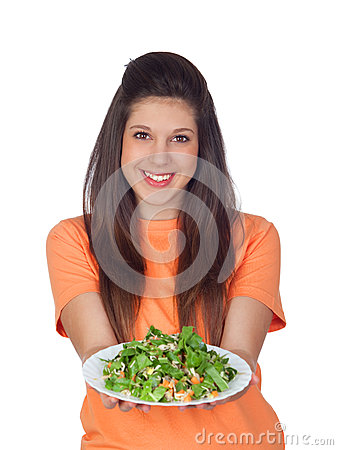 Teenager girl with a plate of vegetables