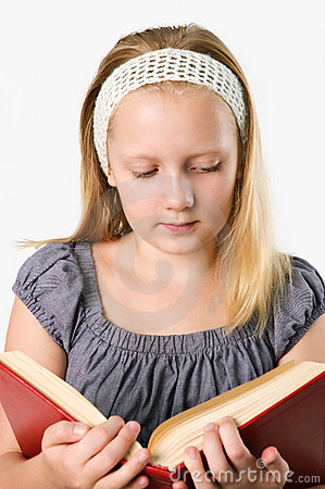 Teenager girl reading a book isolated on white