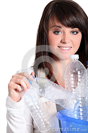 Teenager girl recycling