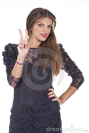 Teenager girl showing victory sign