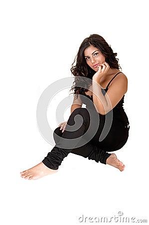 Teenager girl sit on floor.