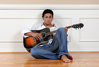 Teenager with guitar
