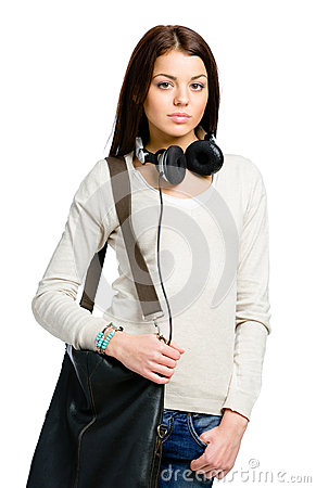 Teenager with headphones and handbag