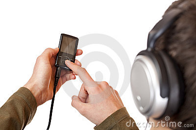Teenager with headset use mp3 music player