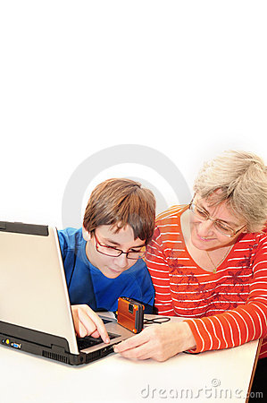 Teenager helping with computer