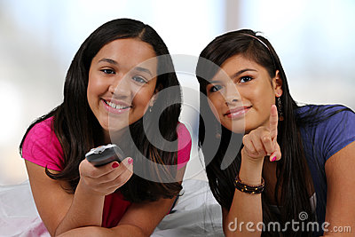 Teenager On Her Bed With Friend