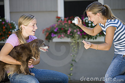 Teenager and her dog posing for picture