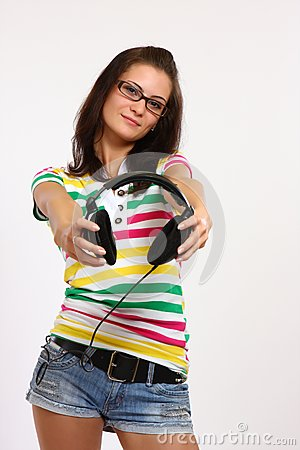 Teenager holding earphone
