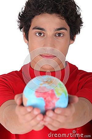 Teenager holding a mini globe