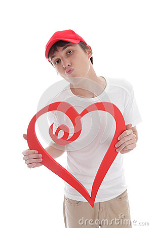 Teenager holding red love heart kiss valentine