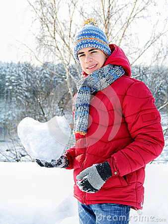 Teenager holding a snowy heart