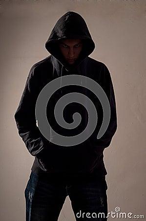 Teenager with hoodie look ahead
