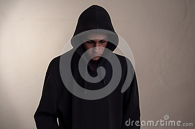Teenager with hoodie looking down