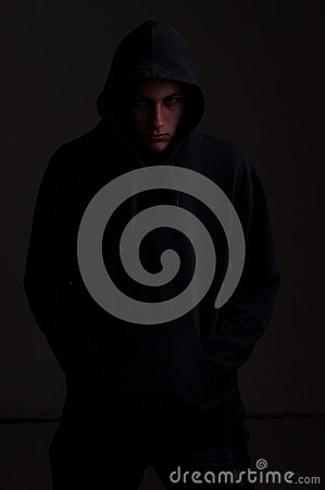 Teenager with hoodie looking to you