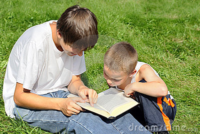 Teenager And Kid With A Book Royalty Free Stock Photo - Image: 13519725