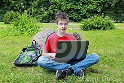 Teenager With A Laptop In The Park Stock Photos - Image: 25260383