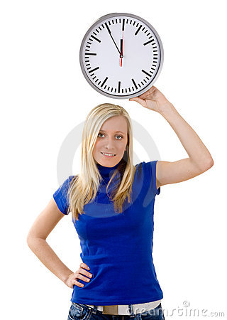 Teenager with large clock