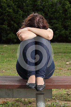 Teenager lonely depressed and sadness in a park
