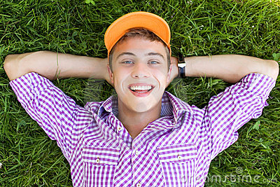 Teenager lying down on grass