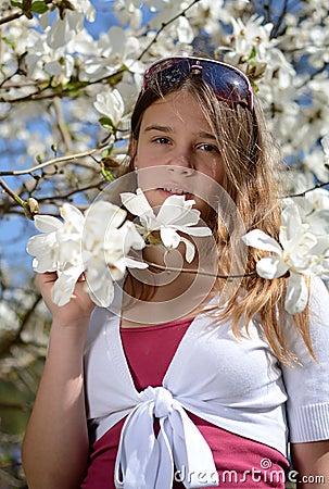 Teenager in magnolia flowers