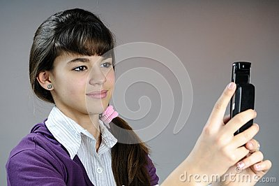 Teenager making photos with mobile phone