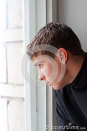 Teenager Near the Window