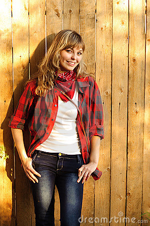 Teenager near wooden wall