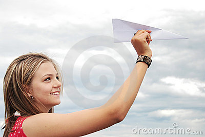 Teenager and paper plane