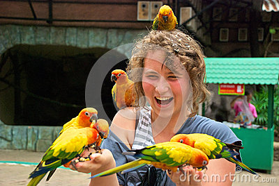 Teenager with parrots