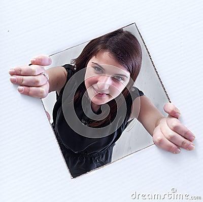 Teenager peeking out of a hole