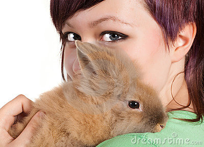 Teenager with pet rabbit