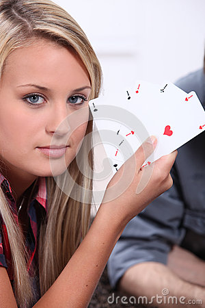 Teenager with playing cards