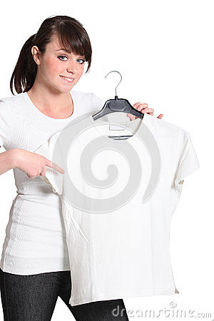 Teenager pointing to shirt