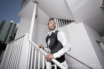 Teenager posing on a staircase