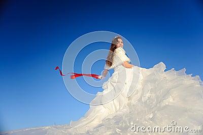 Teenager posing in white wedding dress