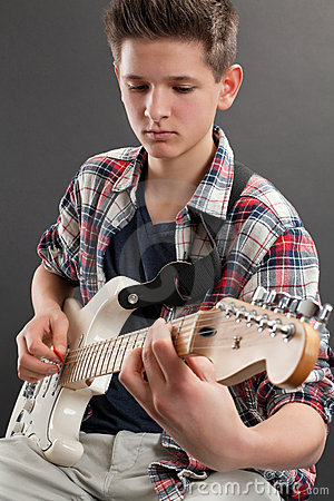 Teenager practicing electric guitar