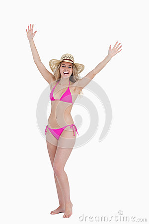 Teenager raising her arms while standing upright