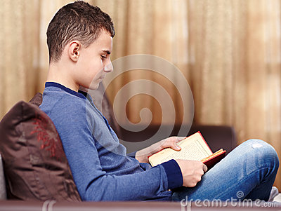Teenager reading a book