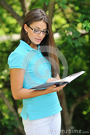Teenager reading book and learn something