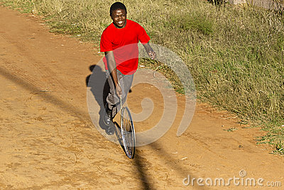 Teenager In Red T-Shirt, Playing with Wheel