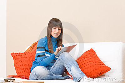Teenager relax with touch screen tablet computer