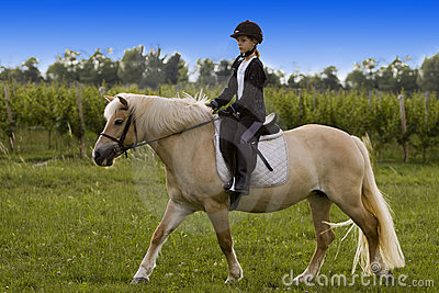 Teenager riding Horse